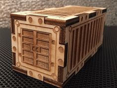 Laser Cut Container for Wargaming like Warhammer 40k, Bolt Action, Dropzone Commander, Planetfall and many more.    Scale is 1:60    If you have no Laser Cutter (probably no), contact your Fab Lab or Maker Lab near you.    Have fun and post your versions of the container. I think i`ll paint mine.