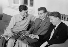 @manutd's Tommy Taylor, David Pegg and Roger Byrne - who all sadly perished in the Munich Air Disaster - reminisce over some action shots before a game in 1957.