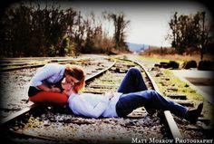Rustic engagement photos on railroad tracks!