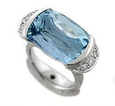 2012AGTA Spectrum Awards  Best Use of Platinum and Color  Michael Endlich, Pave Fine Jewelry: Platinum ring featuring a 19.05 ct. cushion-cut Aquamarine with pave-set Diamonds (.41 ctw.).