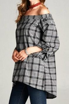 The off-the-shoulder trend continues for fall in this perfect plaid top. Gold Spark Plaid Off Shoulder Top