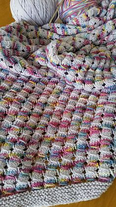 A simple to knit stitch pattern yields impressive results in this quick and warm afghan.