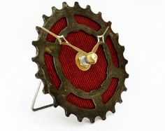 This Tread & Pedals Bike Clock makes a great gift for the cycling aficionado. Tour de France and bicycle lovers will rejoice with the high sheen of the polished recycled bicycle cogs that make up this Bike Gear Clock - its the perfect cycling gift for him, her or your home. Handcrafted with care from recycled bicycle cogs and gears this Tread & Pedals Bike Clock is sure to impress and become the talking piece of any space. This industrial clock will sit proudly on display in the office, home…