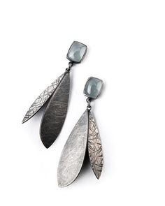 Double Feather Linear Drop Earrings by Linda Azar. Long, light, and full of movement, these flirty drops of oxidized sterling silver feature pairs of hammer-textured wings that float below substantial square-cut aquamarines.