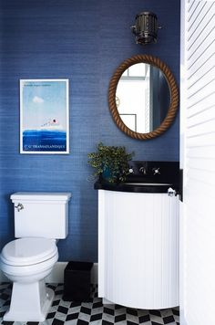 black and blue: black and white tiled floors, navy grasscloth walls, black wastebasket, black countertop