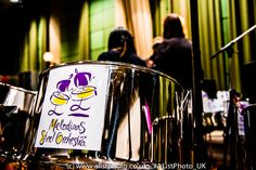 Close-up of the orchestras #SteelDrums #SteelPan with their logo.