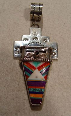 Sterling Silver with inlaid Turquoise, Red Coral, Orange Coral, Sugilite, and Fossilized Ivory. Michael Horse