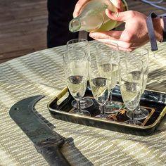 a bottle of sparkling wine opened by billhook, by Heikki Rantala