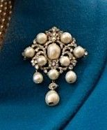 Queen Victoria's 11 Pearl Brooch. 8 in an elaborate diamond setting of a diamond shape with three as pendants. I use the number in the name because those pearls are so instantly distinctive (and to differentiate it from the other well-known diamond and pearl brooch of Victoria's, the Diamond Jubilee brooch). This is one of the items Victoria designated as heirlooms of the Crown.