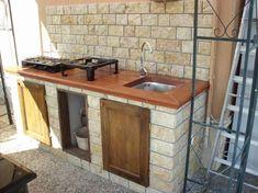 Cucina da esterno rustica - Cucine da esterno in muratura per una casa in stile rustico.