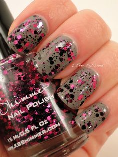 Pink and black spots on silver nails