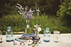 vintage reception decor, blue mason jars, vintage books, lavender centerpiece