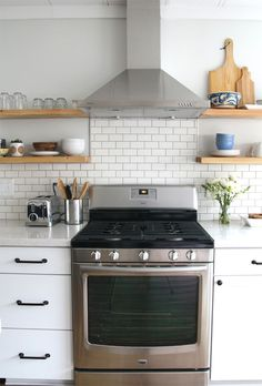 We're loving the subway tile for the backsplash design in this kitchen makeover.