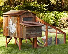 Handmade chicken coop. I love the chicken painted on the side!