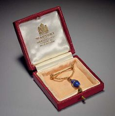 A gold-mounted lapis-lazuli and rock-crystal miniature Egg pendant Marked Fabergé, St. Petersburg, circa 1890 Ovoid, the lapis-lazuli body bisected by a rock-crystal band,