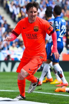 Lionel Messi of FC Barcelona celebrates after scoring his team's second goal during the La Liga match between RCD Espanyol and FC Barcelona at Cornella-El Prat Stadium on April 25, 2015 in Barcelona, Catalonia.