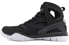 Product Details for NIKE Air Huarache Bball 2012 488054 001    Black / White    The Nike Air Huarache 2012: Minimal bulk and maximum support    Boasting a high-top profile with cut-out detail, the Nike Air Huarache Basketball 2012 Men's Shoe delivers premium lightweight support. The Phylon midsole/outsole combination and Nike Air unit in the heel provide hoops-inspired cushioning.