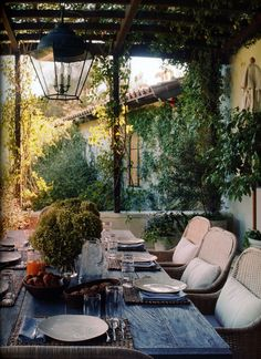 Beautiful, Rustic dining under an arbor