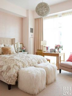 A combination of soft pastels and calming neutrals makes this bedroom a relaxing retreat. The barely-there pink walls and modern floral-pattern bedding create feminine flair. Infusing the space with a variety of textures, like the foot-of-the-bed stools and the dimensional chandelier, ensures the neutral space looks anything but dull.