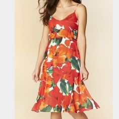 Zara floral peekaboo dress This Zara is adorable! It features a zip up the side, fully lined, peekaboo back with a beautiful red, orange and green floral print. Poly Zara Dresses