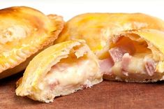 Ham and Cheese Empanadas: a pastry turnover filled with various savory fillings and baked or fried. In this case, were smothering leftover sweet baked ham with shredded cheddar cheese to make these wonderful, easily handheld lunchtime treats. Mexican Food Recipes, Gourmet Recipes, Cooking Recipes, Meat Recipes, Latin Food, Homemade Ham, Turnover Recipes, Leftover Ham Recipes, Leftovers Recipes