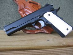 1911 Colt Handgun Pistol....Definitely will be getting a Colt pistol for our Colt one day when he is old enough!