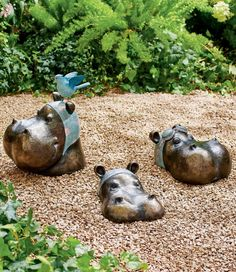 Welcome a unique addition to the wildlife in your yard: three Swimming Hippos look as if they're emerging from a watering hole. Place them strategically within a flowerbed or along the walkway to the pool. Each in the set is crafted from hollow, weather-ready resin with its own personality. Halloween Flowers, Halloween Decorations, Garden Oasis, Grandin Road, Metal Homes, Flower Boxes, Garden Sculpture, Wildlife, Swimming