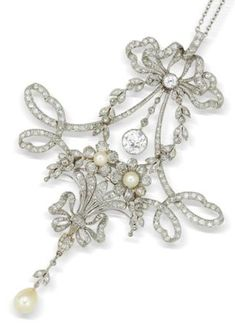 A belle époque diamond and pearl pendant, attributed to René Boivin, circa 1905 In the garland style, the rose-cut diamond ribbon bow surmount suspending an old brilliant and rose-cut diamond drop, terminating in a rose-cut diamond and seed pearl tied flower posy suspending a pearl drop, to a trace-link chain, unsigned, numbered, fitted case by René Boivin Joaillier 38 Rue de Turbigo Paris.
