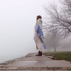 "Heidi Parkes with her art quilt, ""Beginners,"" on a foggy day in Chicago by Lake Michigan. #quilt #handquilted"
