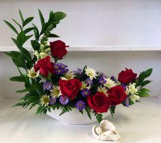 One of our unique Crescent arrangements available at Edwards Flowerland