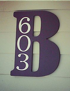 Pick up a letter at Hobby Lobby or craft store, paint it your color, add house numbers!Loveeee it!!!