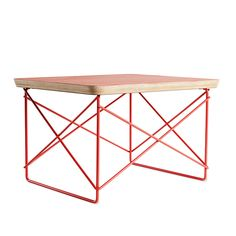 """The Eames Wire-Base Table (1950/2012) is remarkable for the elegance it achieves using simple, practical materials. Its scaled-down profile shows the influence of Japanese forms and households based on an aesthetic ideal of simplicity, serenity and restraint. In fact, the Eameses used this table in their home during a tea ceremony that included Isamu Noguchi and Charlie Chaplin. Just 10"""" high, it provides a handy surface for a stack of books or a place to rest a drink. To honor the late Ray…"""
