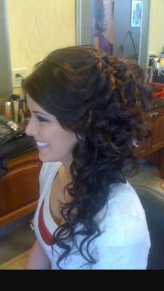 Side swept up do with curls