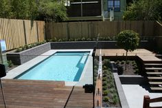 Swimming Pool at Bardon with decks yet to be stained and creating levels on sloped block. Landscape Design & Construction