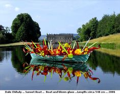 Dale Chihuly Glass on the Lake at Chatsworth House, England. Two most unbelievable pieces of art.