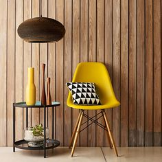 Yellow Vitra Eames DSW Chair with black and white graphic cushion