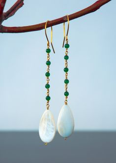 A personal favorite from my Etsy shop https://www.etsy.com/listing/216541884/14k-gold-plated-silver-earrings-white