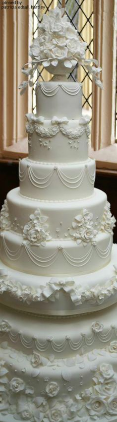 Resplendent, towering wedding cake all in white.                                                                                                                                                      More