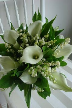 Calla Lily & Lily of the Valley Bouquet. I'd like my dress to be as clean and structured as the Calla Lilies. Calla Lillies Bouquet, Calla Lily Flowers, Calla Lily Wedding, Lily Bouquet, Wedding Bouquets, Wedding Flowers, Lily Of The Valley Bouquet, Floral Bouquets, Floral Arrangements