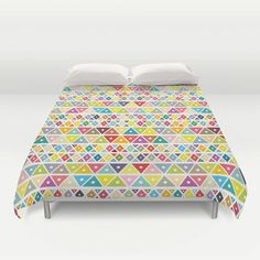 "Sleep and dream of colours with our ""Colourful Ethnic pattern"" duvet cover*. This geometric duvet cover will lighten up any room. It is also a perfect gift for any kid."