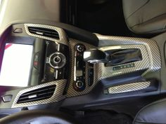 2013 Ford Focus in white pearl with black carbon fiber interior, by Liquid Carbon Shop. Ontario Canada's premier hydrographic shop.