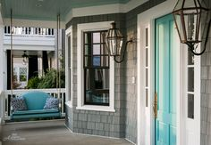 Front door & ceiling are painted in Waterscape by Sherwin Williams.