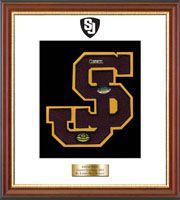 St. Joseph High School in Connecticut Varsity Letter Frame - Showcase your varsity letter in our Newport solid hardwood shadowbox frame in cherry finish with black accents and gold lip with hand embossed St.Joseph High School logo, on our white and black museum quality matting. A personalized engraved plate is included.