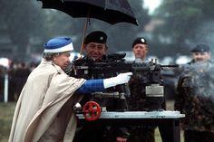 Queen Elizabeth II fires a British L85 battle rifle (1993).