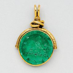 Antique Emerald Intaglio and 14K Gold Fob   Suspending a swiveling circular emerald intaglio weighing approximately 25.00 carats, depicting a deer holding an arrow, 19th century