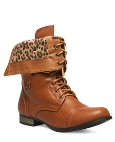 These brown lace-up combat boots have a chic fold-over accent that ...