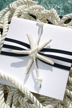 Nautical gift wrap-white paper, black & white stripe ribbon with shell