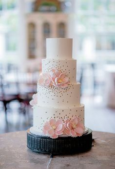 With a classic look throughout the rest of their Charleston, South Carolina, wedding, Alexis and Bill knew they wanted a very traditional dessert. Cakes by Kasarda baked this layered confection, with flavors like lemon cake with raspberry filling and strawberry cake with fresh berries, covered in Italian buttercream and decorated with sugar flowers.