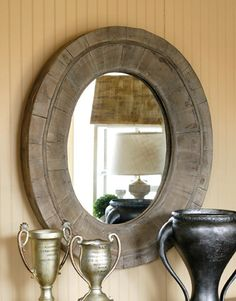 """Reflections of farmhouse style. Reflections of your style. Reflections of beauty. Primitive Wooden Oval Mirror 28"""" x 32 _________________________________________________________ Please note that these mirrors are primitive in their crafting and materials, to intentionally give an old world farmhouse feel. Each mirror will be unique in its wood grain and slight imperfections in finish are due to use of reclaimed wood. Spacing and gapping in wood slats will vary, as part of this mirror's…"""