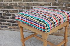 Upcycling gone AWESOME...old ottoman reupholstered with an old hand-knit blanket.  Mmm.